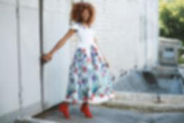 Black Lady in floral dress smiling - Pex