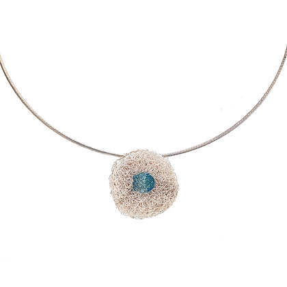 pod pendant with blue topaz