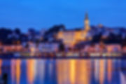 Panorama of Belgrade at night with river