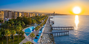 Sunset in Cyprus. The sun sets in the Mediterranean. Limassol at sunset. Evening panorama