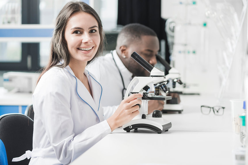 cheerful-medic-woman-at-micoscope.jpg