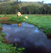 water harvesting earthworks swale, spillway swale crossing