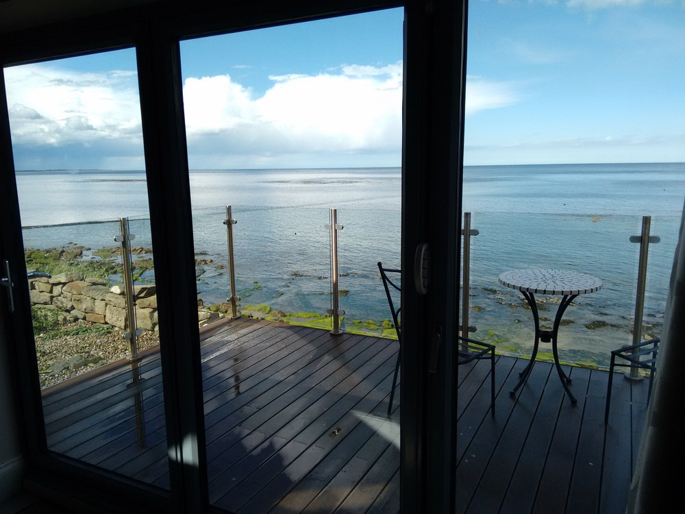 Looking over the balcony of Bank top Cottage, Cresswell, at the sea view of Druridge bay
