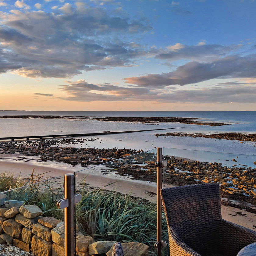 Sunset Cresswell northumberland beach cottage balcony glass rockpools clouds orange sky sea grass rocks sand sea
