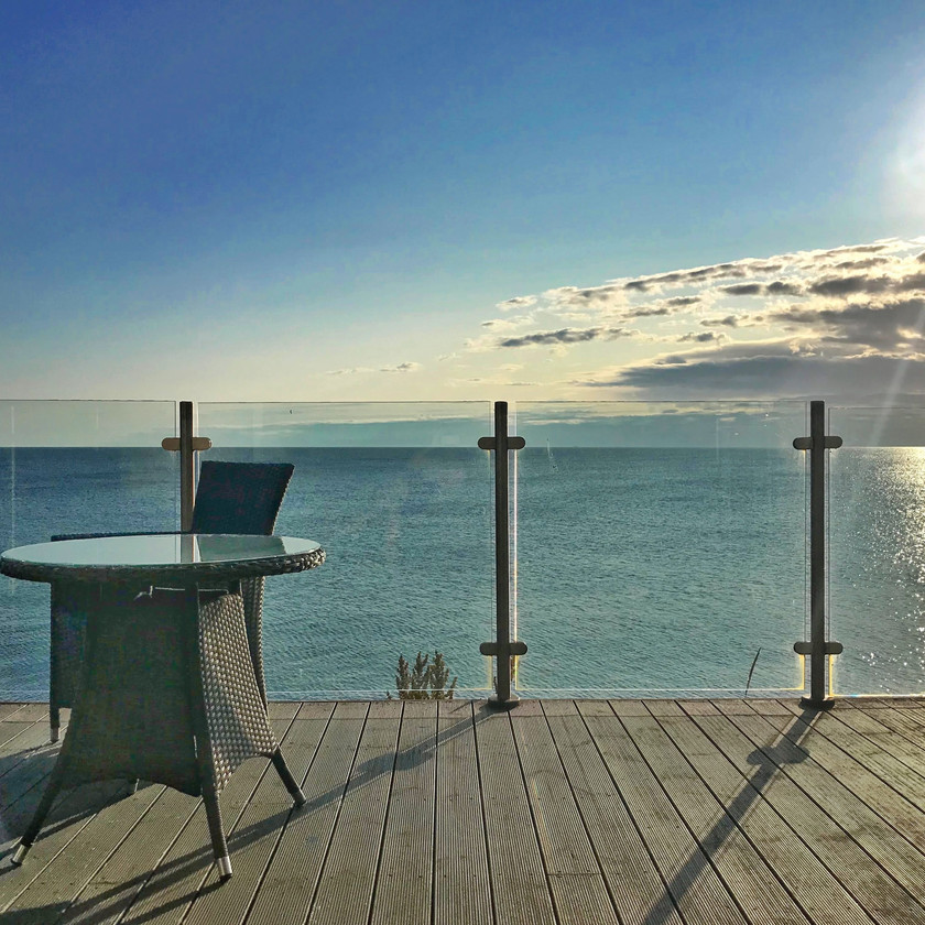 Sea view balcony sun chair blue sky summer holiday cottage beach northumberland