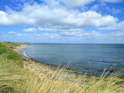 Cresswell beach at high tide from Snab Point in Northumberland