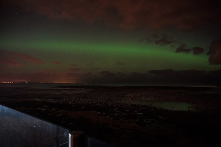 The aurora borealis or northern lights over Druridge bay, Northumberland