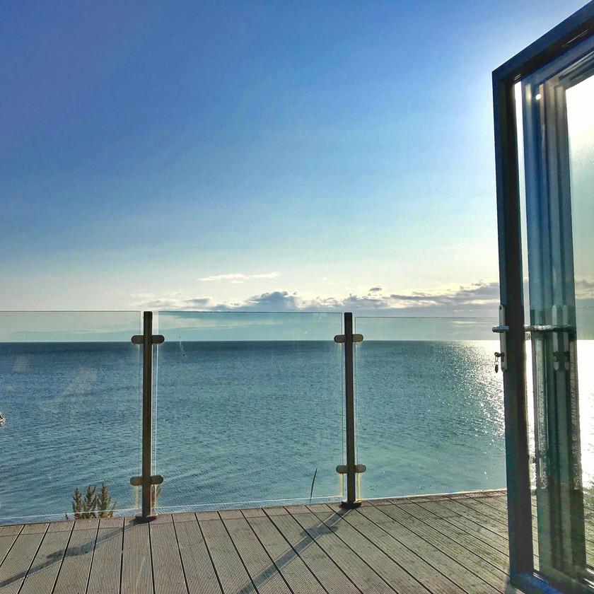blue sea sun north sea sea view beach balcony cottage northumberland bifolding doors