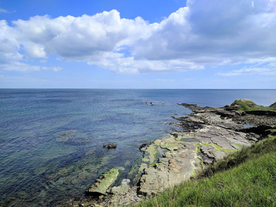 Snab point rocks and blue north sea at Cresswell Northumberland