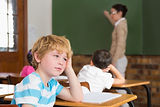 Cute pupil not paying attention in classroom at the elementary school.jpg