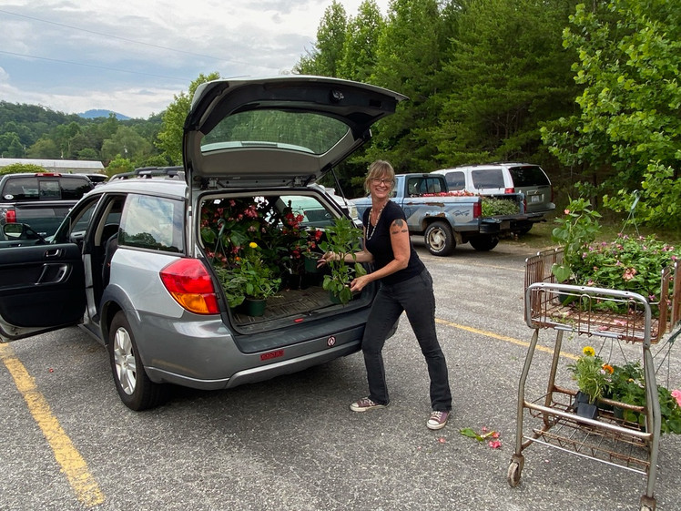 The Black Mountain Public Library was there to get flowers for their gardens, including a beautiful memorial garden everyone should visit.