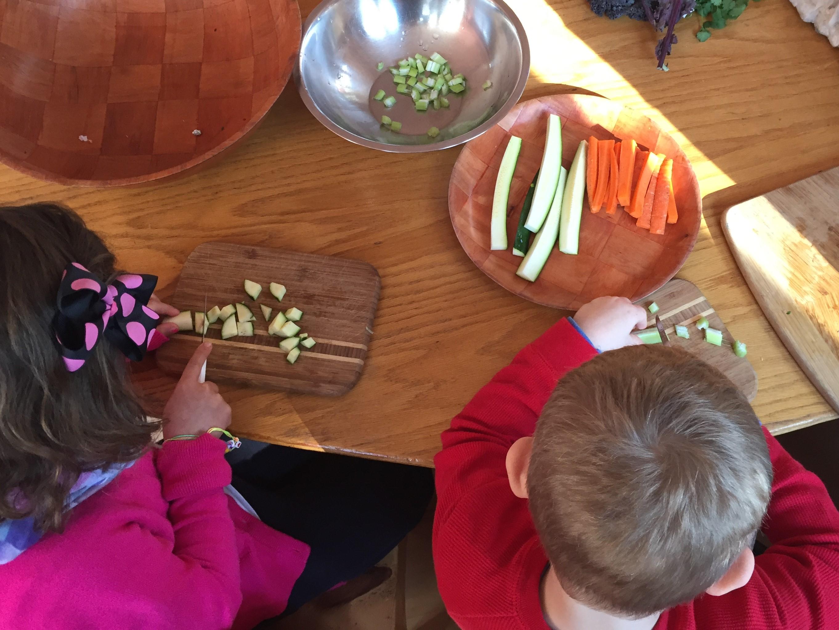 In our kindergarten program children help prepare daily meals.