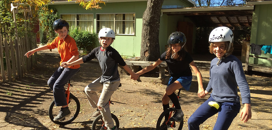 Waldorf students on the unicycles.