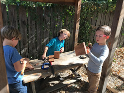 The kindergarten class working on their woodworking projects.