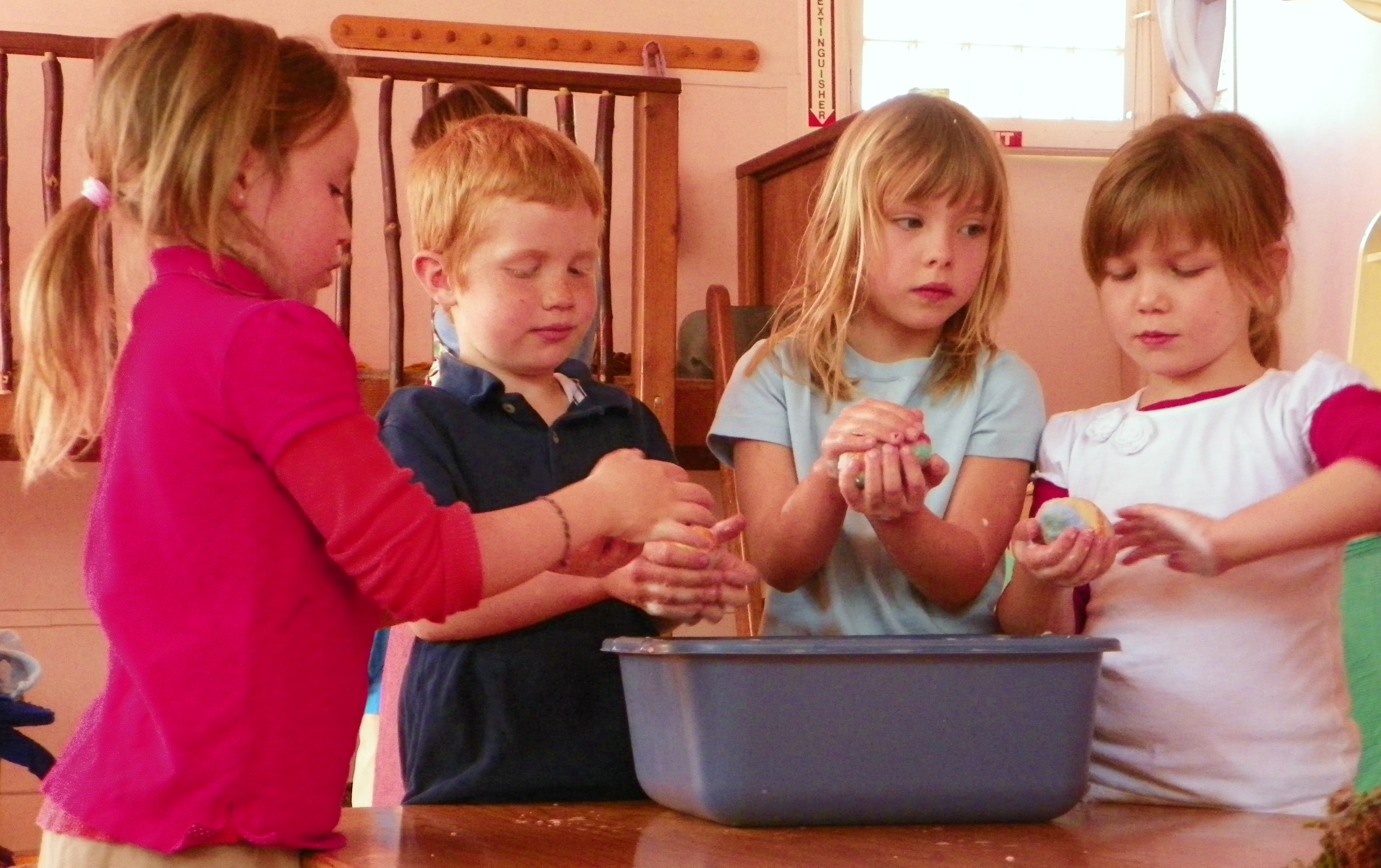 Kindergarteners washing hands before a meal together.