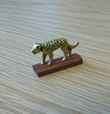 Leopard on wood stand.jpg