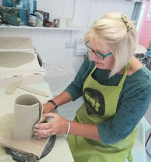 Susan Luker working in her studio re siz