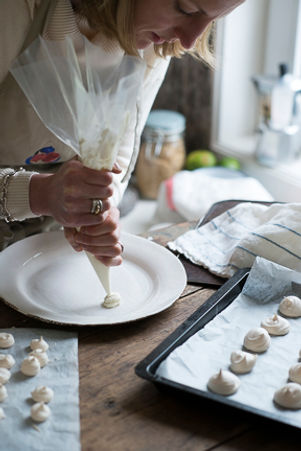 Chef piping meringue