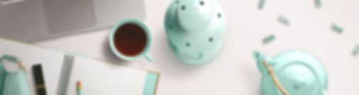 Teal workspace with tea
