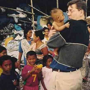 With children in a garbage dump near Denpasar, Bali, Indonesia - an ephiphany moment in which Jim decide to leave Wall Street.
