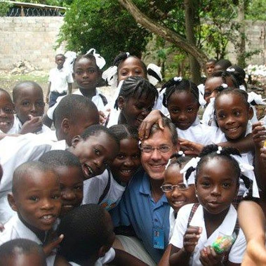 Jim Luce with kids in Léogâne, Haiti after the earthquake (2010)