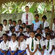 With our kids after the Tsunami outside Galle, Sri Lanka.