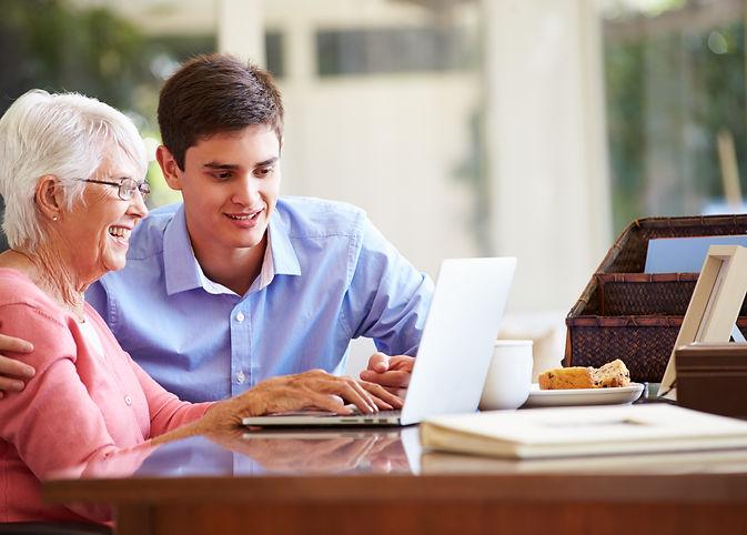 Teenage Grandson Helping Grandmother Wit