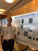 UG Kendrick presents his poster at the summer forum