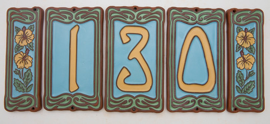 blue with yellow tile house numbers