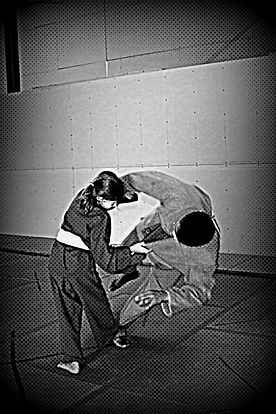 A Team Torque student practicing her martial arts skills on one of the instuctors