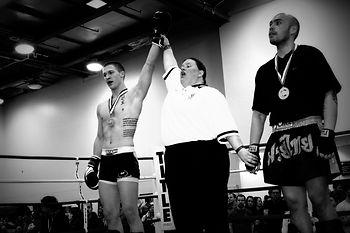 A Team Torque student winning his martial arts fight