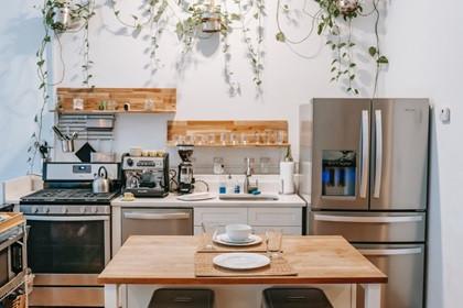 A makeshift kitchen island in a pretty kitchen