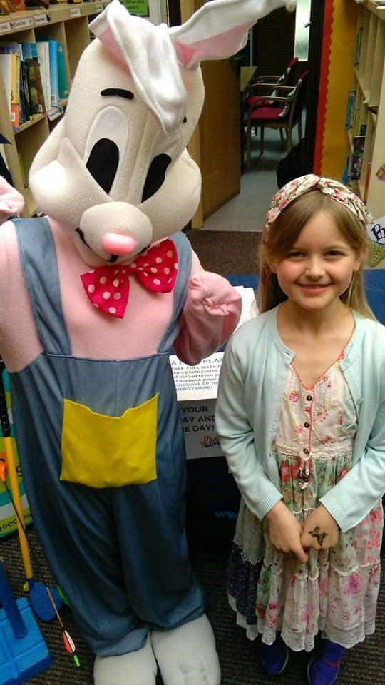 Easter Bunny with Willow Bridger taking a selfie, the winner of the Junior Easter Bonnet Competition