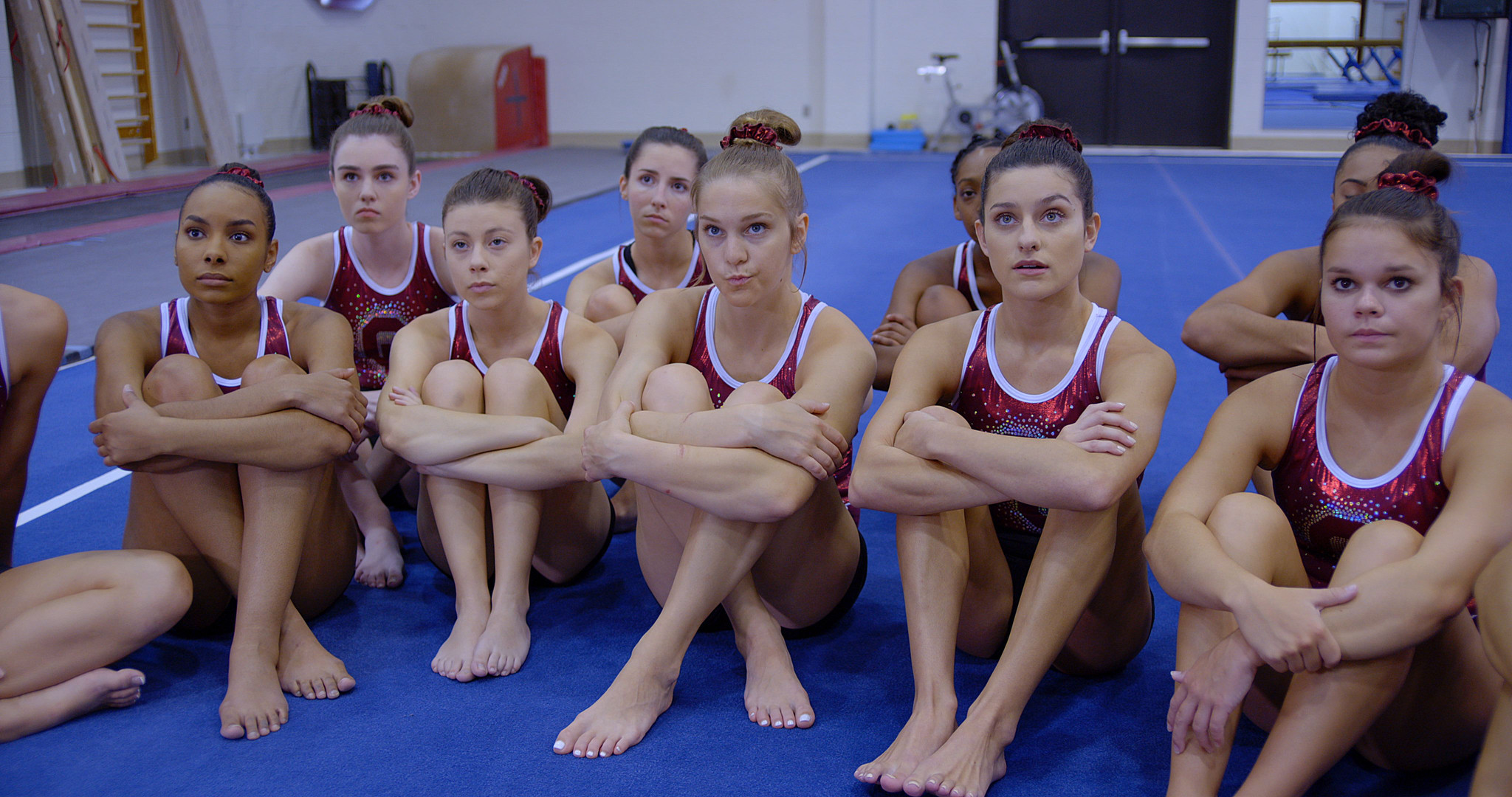 Gymnasts listen to Coach.jpeg