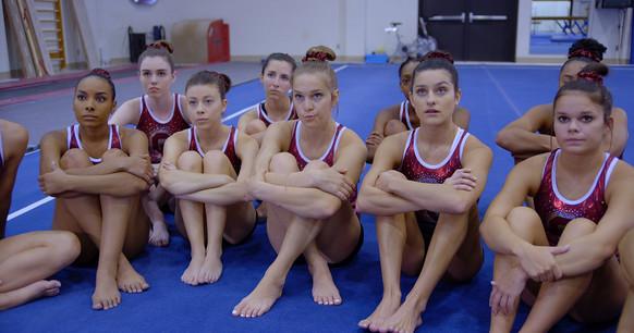 Gymnasts listen to Coach.jpeg