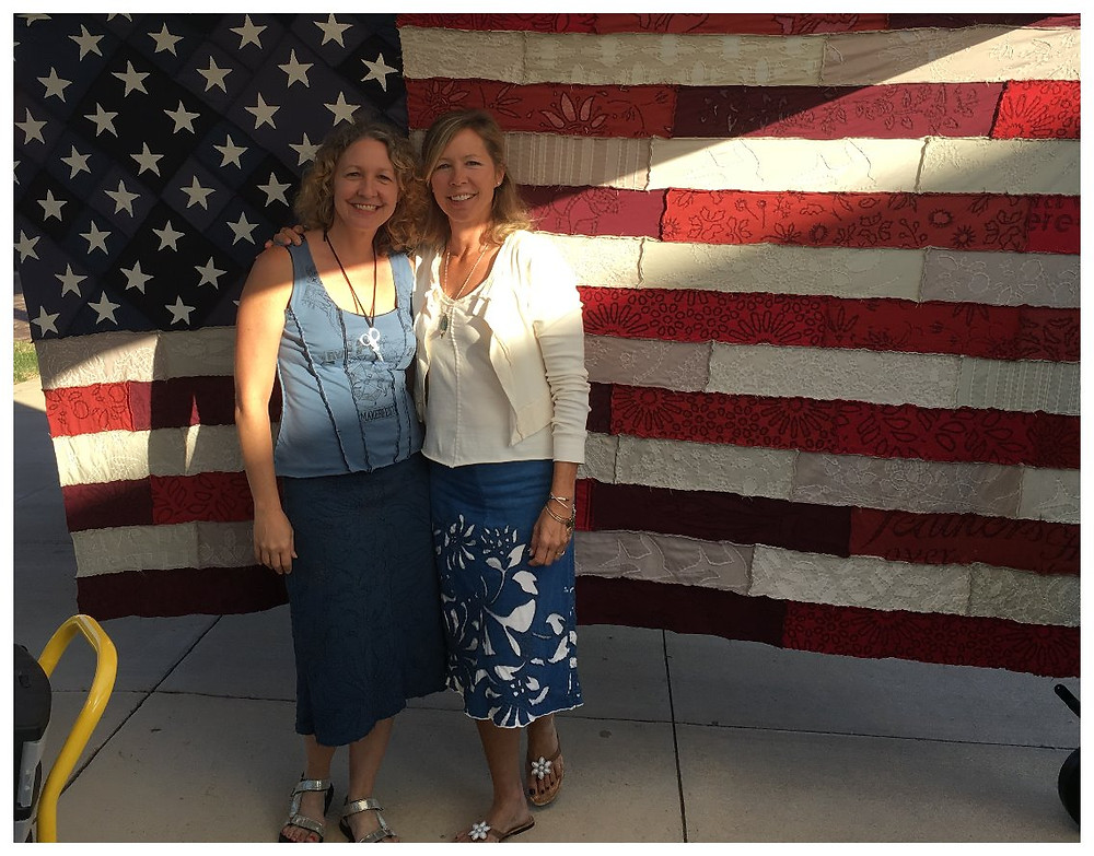 Sue and I in front of an AC flag she hand-sewed and wearing clothes we made.