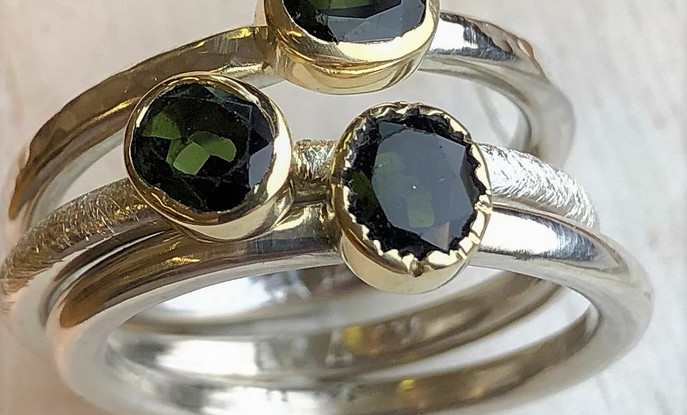 3 silver rings studded with Green tourmaline.