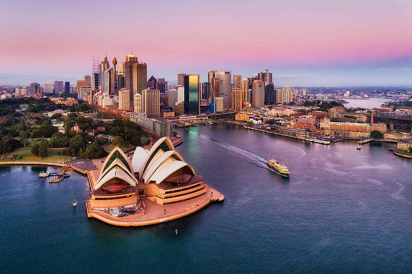 Pinkish colourful sunrise over Sydney ci