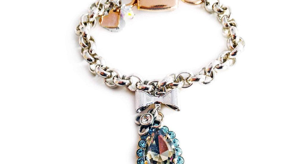 Link Bracelet With Light Blue Swarovski Crystals Silver, Rose Gold Plated Brass.