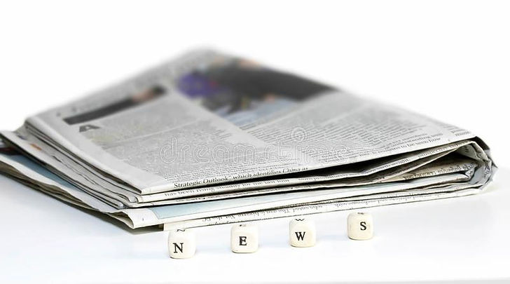 newspaper-folded-wooden-abc-text-white-b