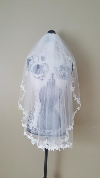 Mid hip length veil