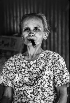 Old lady smoking cigar
