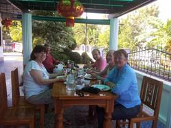 Five guests enjoying breakfast