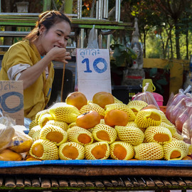Girl eating fruit at the market