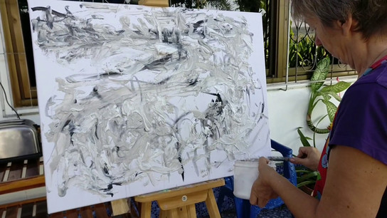 Artist painting with acrylic modelling paste