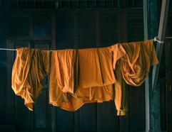 Saffron robes on a clothes line