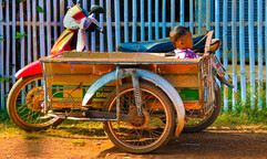 Motorbike with sidecar with child Thaila