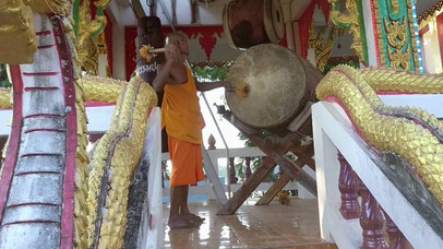 Monk drumming a few hundred metres from our guest house Thailand Painting Holidays