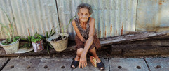 Old lady sitting in the street in Thaila