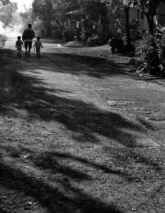 Drawn to light man and two children in T